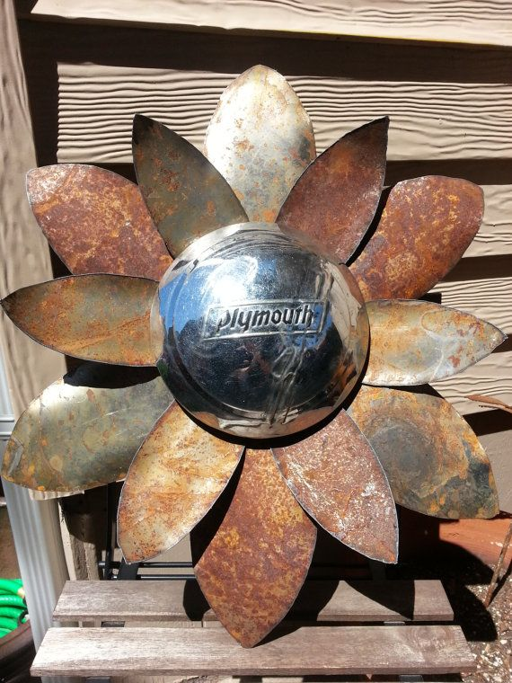 Rusted hammered metal flower wall hanger with Plymouth hubcap yard art by MyRustedRoots