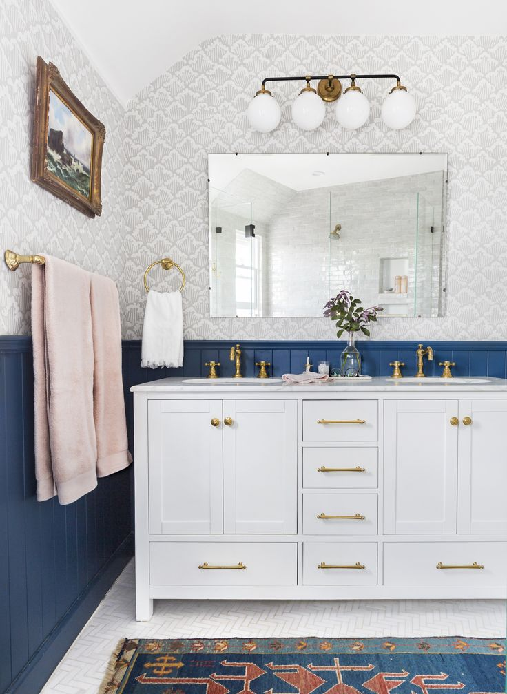 Cute bathroom, I love the blue and the brass together.  Article about water softening system.