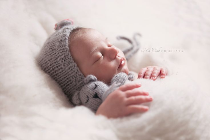 Backlight newborn photography pose by nawink photography in windsor ontario