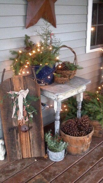 Rustic Christmas Porch...old baskets with pine, lights & cones.