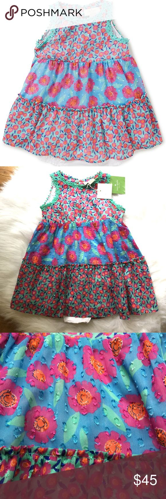 Kate Spade Babies Trapeze Dress Set Dress is polyester lined in 100% cotton. Comes with white cotton bloomers. Color is tangier floral kate spade Dresses