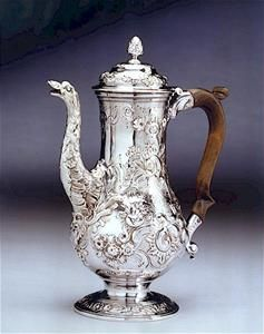"""A fine quality Georgian sterling silver coffee-pot by Aymé Videau London, dated 1750 Fully hallmarked. """"The majority of his [Aymé Videau's] output seems to have been hollow ware, coffee-pots tea-caddies etc., of high quality and, from the mid-thirties, with particularly graceful flat chasing"""". Here we also see him as a master of embossed decoration. Videau was an apprentice to fellow Huguenot David Willaume Goldsmith"""