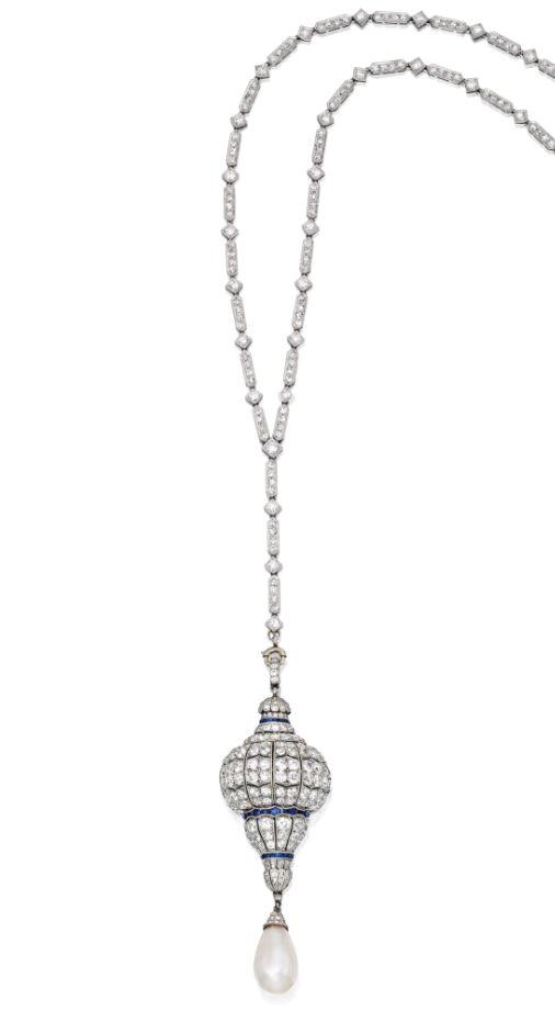 Sapphire, diamond, pearl and platinum watch pendant, on a diamond and platinum necklace, circa 1920.