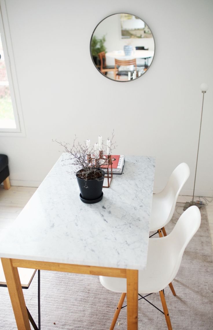 Ingrid Holm Blog - bianca carrara marble table, vitra eames chairs, round mirror