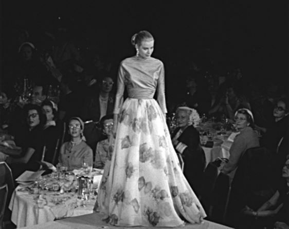 """princessgracekelly1956: """" Grace Kelly models a gown by Leslie Morris of Bergdorf Goodman during the March of Dimes Annual Fashion Show at the Waldorf Astoria. (1955) """""""