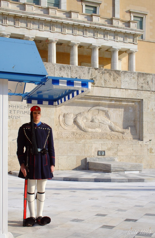 Presidential Guard (Evzones) with the traditional winter uniform at the Tomb of the Unknown Soldier in front of the Hellenic Parliament. Constitution Square (Platia Sintagmatos) of Athens.