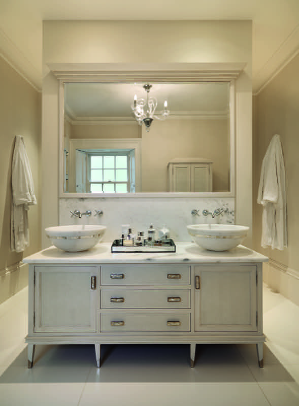 In perfect symmetry – Deco-style detailing, mother of pearl inlay and carved marble basins add a stylish opulence to the vanity cabinet #Smallbone