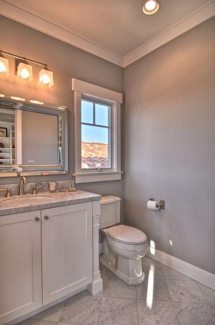 Master bath color scheme white and gray with silver bathroom decor.