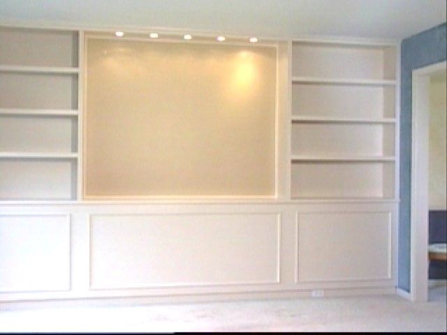 wall mounted tv and shelving idea