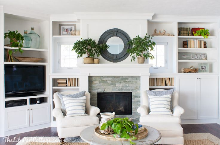 I like the bookcases and TV area on either side of this fireplace :-)