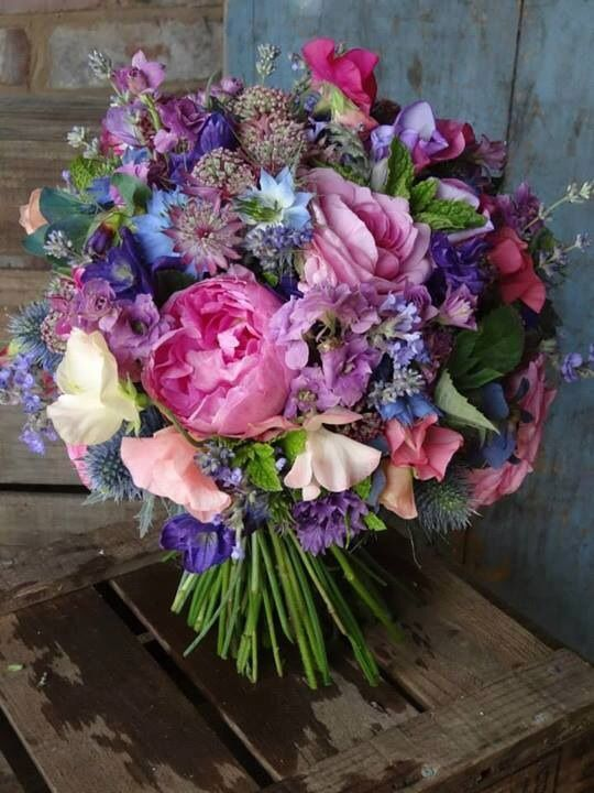 lush purple wedding bouquet, the pink and blue tones of the flowers just mesh so well together! Love it! Click follow to see more of our amazing pins and bouquets or follow us on Instagram @bellebouquets #BelleBouquets - moncheribridals.com #weddingbouqeuts