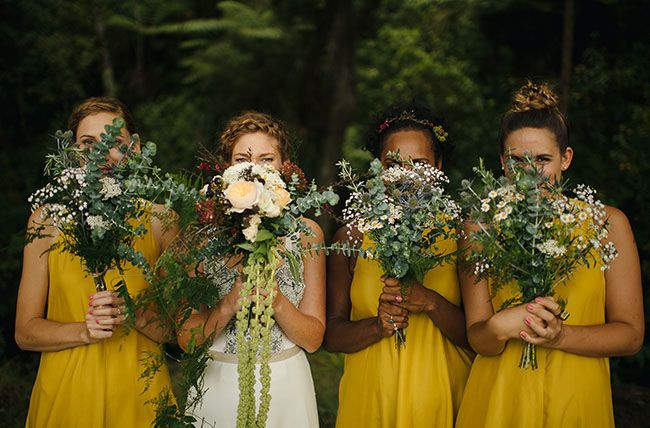 haley likes these bridesmaid bouquets except would want to replace little daisies with something else like stock or ranunculus