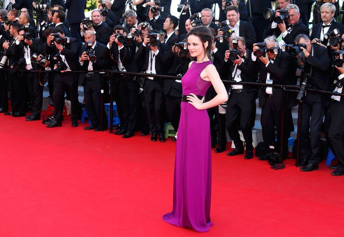 German actress Emilia Schuele was stunning in a belted magenta dress as she too attended the premiere of 'How To Train Your Dragon 2' at the 67th Cannes Film Festival - May 2014. (Source: Reuters)