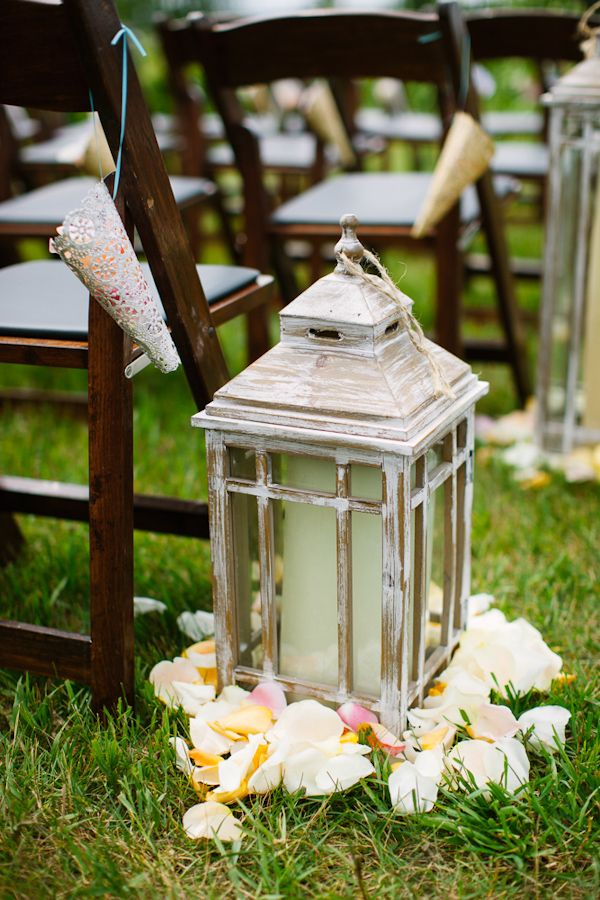 wedding lantern decorations vintage style lanterns with candles and flower petals as 9791
