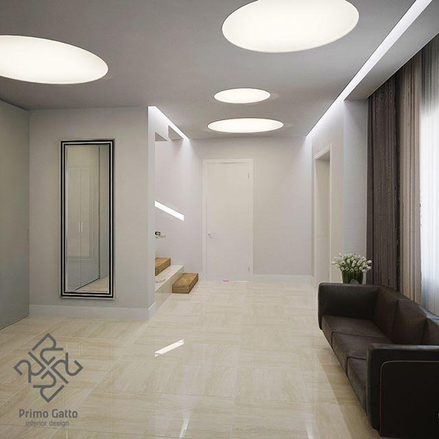 Наш дизайн-проект холла в современном стиле. Лаконичное сочетание глянцевых поверхностей пола и шкафа, белые стены и большие круглые встроенные светильники создают атмосферу легкости и воздушности.