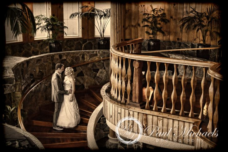 Bride and groom on the stairs at Wallaceville house wedding.