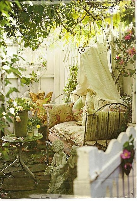 Leafy outdoor room - how wonderful would it be to sit there on a warm afternoon with a cup of coffee and a good book!