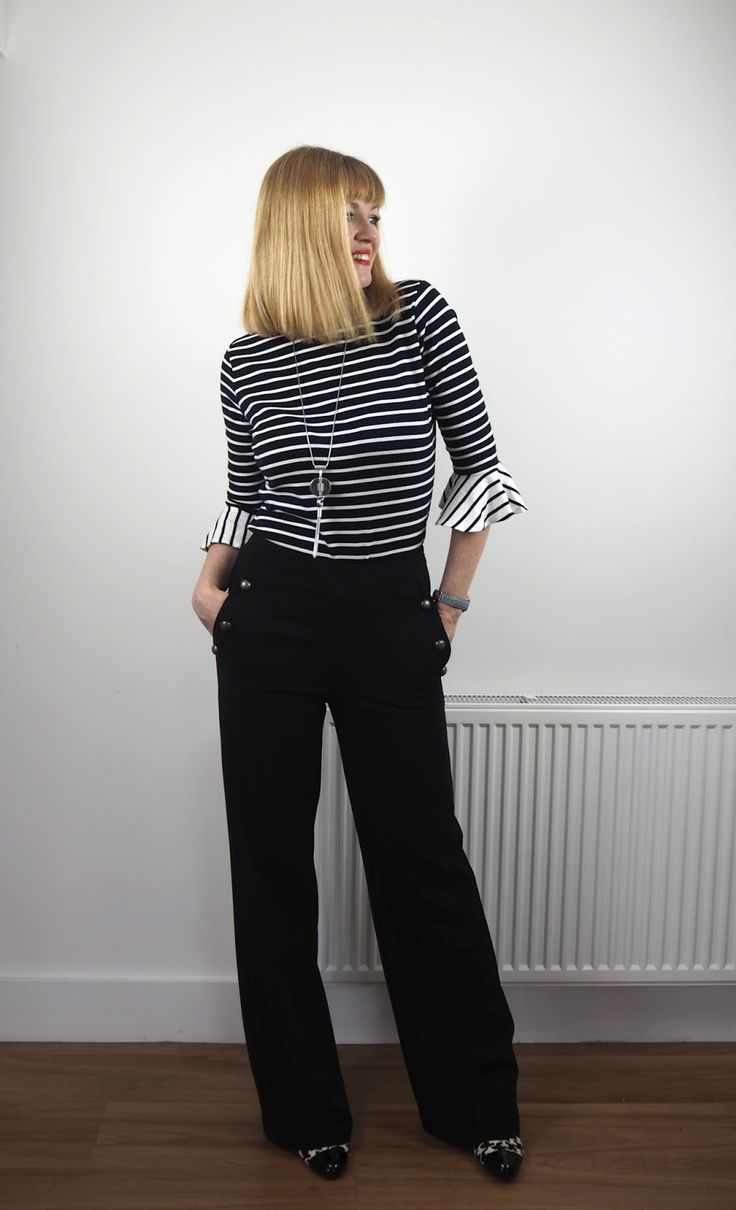 Breton stripe top with fluted sleeves and black wide-legged sailor trousers