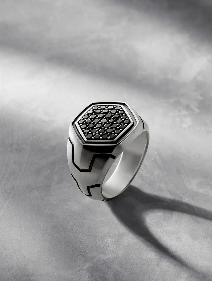 Forged Carbon men's signet ring with black diamonds.