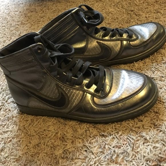 Silver Nike Hi Tops These are too cool and I'll miss them greatly! EUC just a few minor scuffs. Soles still in great shape. Lighter silver has snakeskin pattern embossed. Nike Air. From Urban Outfitters. Make an offer! Nike Shoes Sneakers