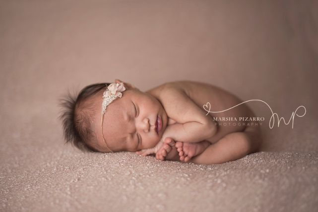 newborn photographer calgary baby-girl-pink-backdrop-taco-pose