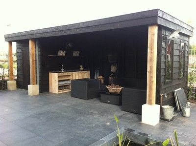 garage - idea of shed to drive and open to patio (with garage roll down door)