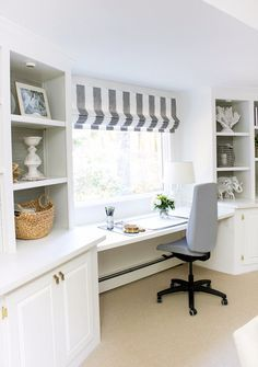 desk area with window between two builtin bookcases