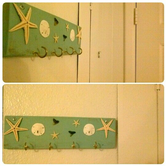 DIY key holder made with  painted pallet wood, real star fish, sharks teeth and sand dollars from Venice, FL.