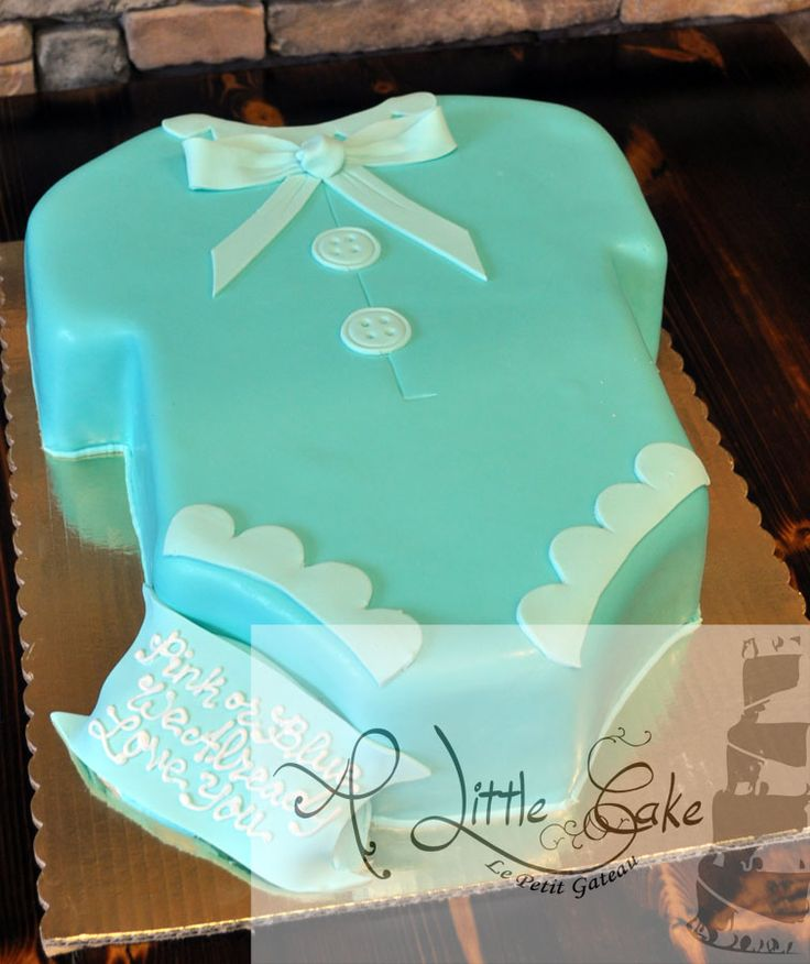 Baby Shower Onesie Cake. Look how adorable this onesie baby shower cake turned out. This fondant iced cake is simple yet cute and to the point. The way this cake is designed leaves us with the option to add more detail or keep this clean look. When budget needs to be a concern this design style of baby shower cakes should be considered. http://www.alittlecake.com/category/baby-shower-cakes/