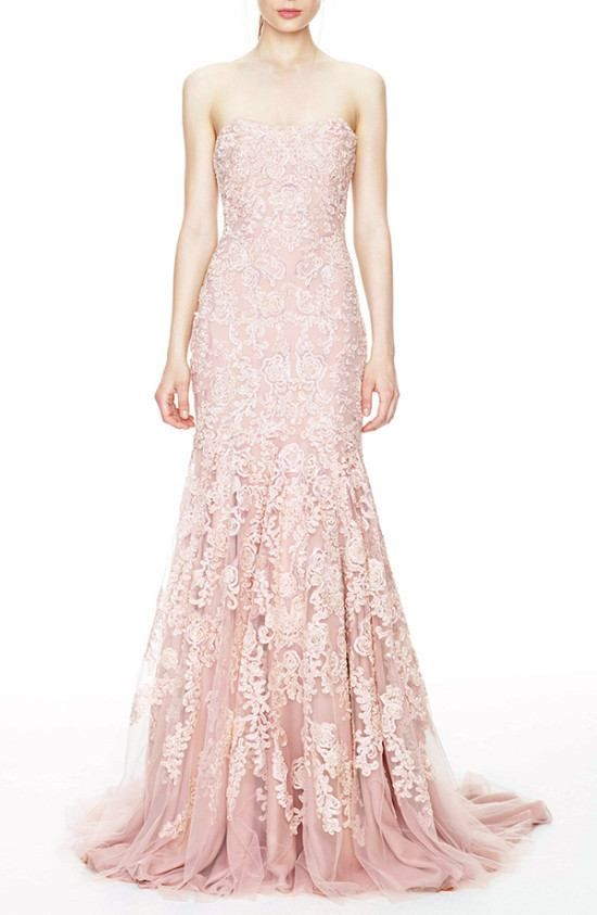 18. Marchesa Blush Wedding Gown (price upon request) This Marchesa blush wedding gown exudes femininity and romance. With an intricate lace overlay, and a figure flattering shape, we can already see you gliding down the aisle in this blush wedding dress.