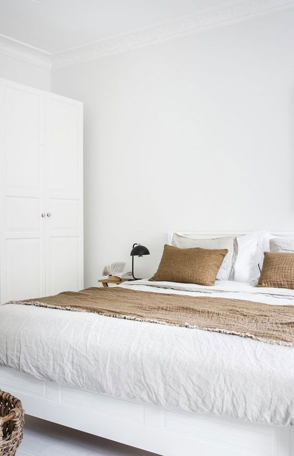 bedroom in white & natural fabrics
