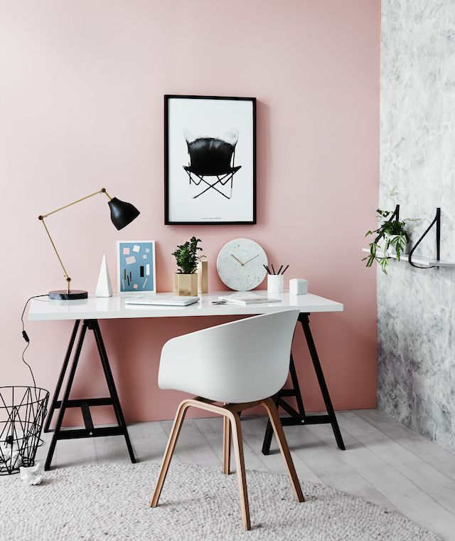 This unexpected pink wall perfectly compliments this modern office space.