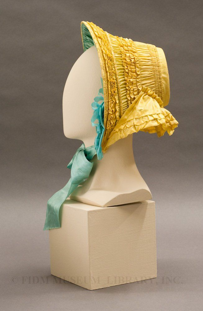 Side view. 1852 Easter bonnet belonging to Sarah Elizabeth Craft. Silk taffeta & silk ribbon. Story goes that this young girl never got to wear this.