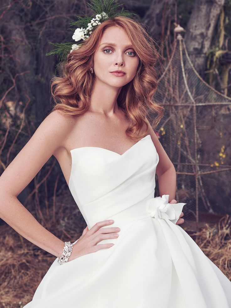 Maggie Sottero - MEREDITH, This simple yet glamorous Cameo Organza ballgown features a softly pleated bodice and voluminous pickups in the skirt. A distinctive sweetheart neckline and handmade 3D floral motif, accented with Swarovski crystals, at the hip and skirt add unique romance to this wedding dress. Finished with zipper closure.