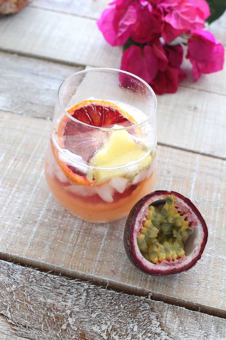This sangria packs a punch (pun fully intended) with guava, orange, blood orange, mango, passion fruit, and pineapple. Ingredients: 1 bottle of ONEHOPE Sauvignon Blanc (half of the profits go to Save Our Planet) 1/2 cup guava juice 1/4 cup orange juice 1 cup pineapple (cut into 1″ wedges) orange slices blood orange slices (optional) mango slices passion fruit (seeds and juice from 1 passion fruit)  Directions: 1. Combine all ingredients in one of your sangria bar carafes and seal tightly…