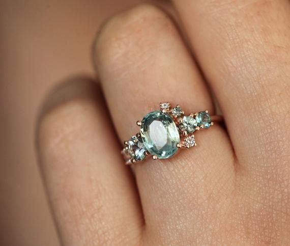 Light Green Sapphire Engagement Ring Cluster Ring Oval Etsy Green Sapphire Engagement Green Sapphire Engagement Ring Engagement Rings Sapphire