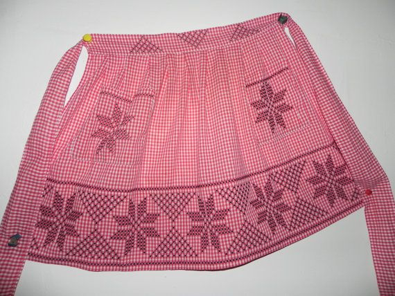 REMEMBER HOME EC CLASSES ??  one of my favorites and I have a lot of aprons but this one is made from red and white gingham and someone has hand cross stitched in black across