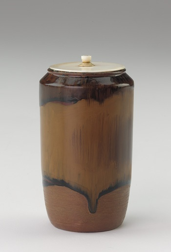 Tea caddy imitating Takatori ware  ca. 1700-1868    Edo period     Lacquer on unknown base; ivory lid  H: 7.0 W: 4.2 cm   Japan . Ceramic tea containers are used customarily for the preparation called thick tea, while lacquer containers are used for thin tea. This lacquer posing as ceramic playfully crosses boundaries.