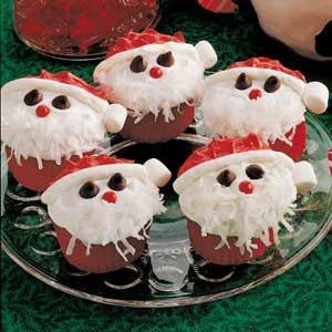 Santa cupcakes with flaked coconut, red-hot candies, miniature marshmallows and chocolate chips...too cute!