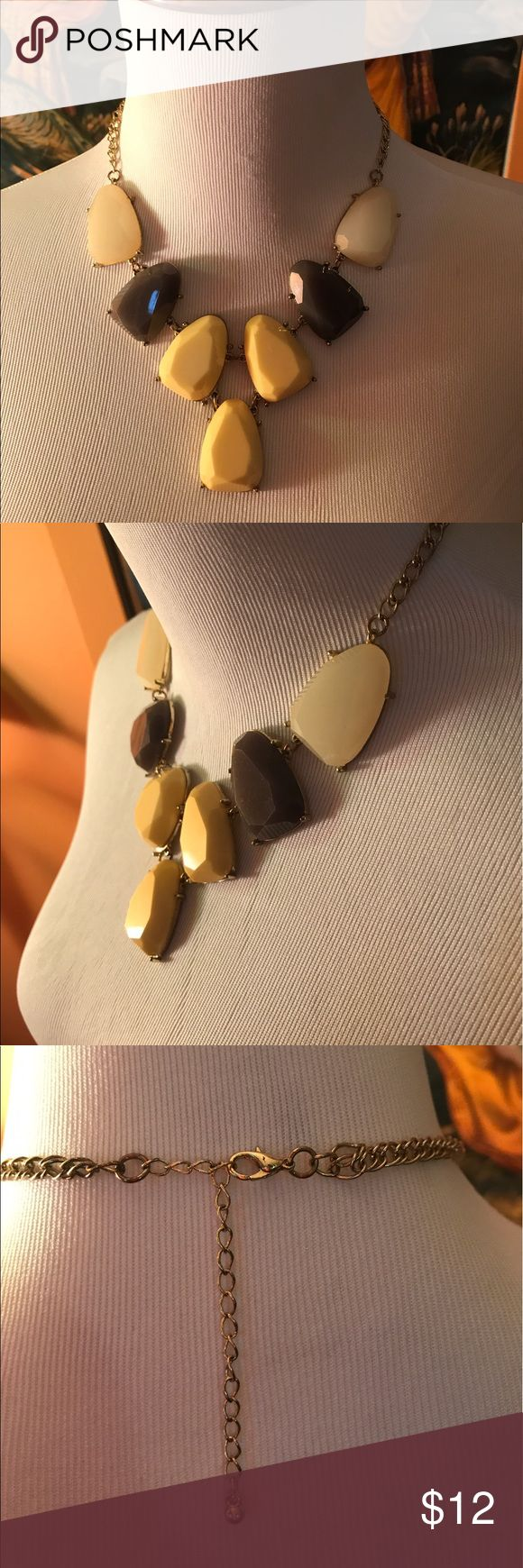 Gray yellow and white statement necklace Gray yellow and white plastic stone statement necklace is absolutely stunning! Looks great in business attire Jewelry Necklaces