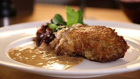 Juicy potato crusted pork chops with creamy cider mustard sauce - hairy bikers