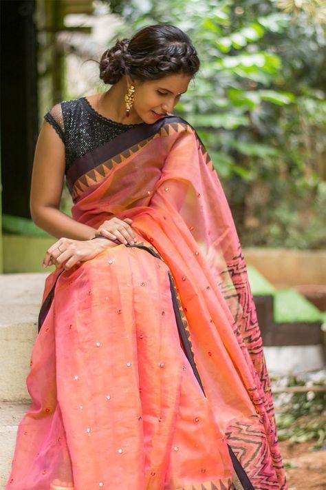 Pinkish orange silk Kota saree with mirror work and black temple border #saree #blouse #houseofblouse #indian #bollywood #style #peach #pink #orange #mirrorwork #kota #black #temple #border #zigzag #print