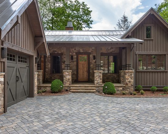 Rustic Exterior of Home with exterior stone floors, Pathway, Raised beds