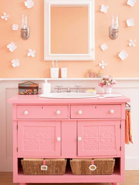 Dresser Do-Over  An outdated bedroom dresser found new life in this youthful bathroom. A fresh coat of cheery pink paint spiffs the structure up. Although the top drawers give up storage function to the plumbing, behind the cabinet doors is space for beauty supplies and towels. Removing the dresser's bottom drawer offers room to add decorative storage baskets.