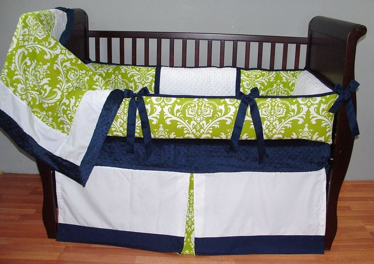 Parker Baby Bedding  This custom 3 pc baby crib bedding set includes a modern plush bumper pad, tailored crib skirt, and so soft minkyedged and backed blanket.  The modern green apple damask print, navy piping and trim, navy grosgrain ties, white pique, and ultra soft white and navy minky combine softness and textured detail. Top quality and a modern touch for your little angel's nursery.