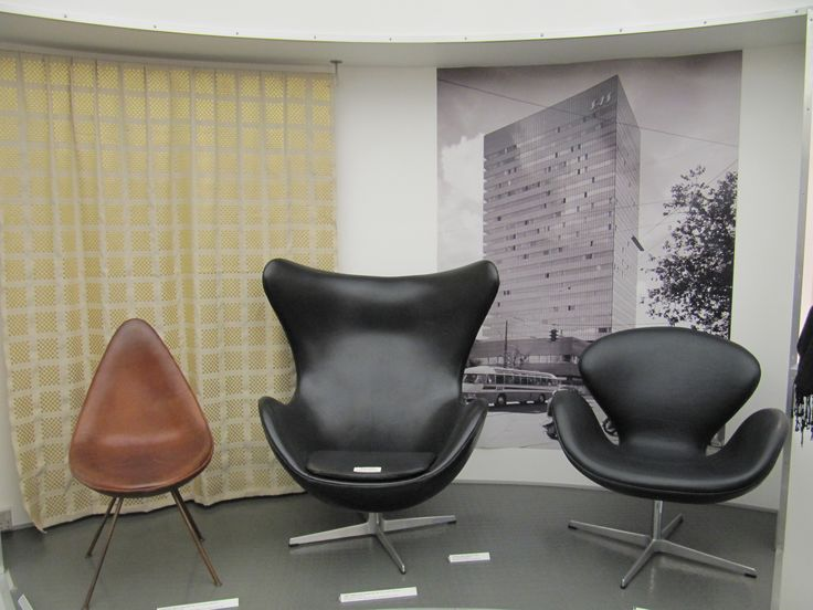 Drop, Egg and Swan chairs designed by Jacobsen for use in the SAS Royal Hotel (pictured in background).