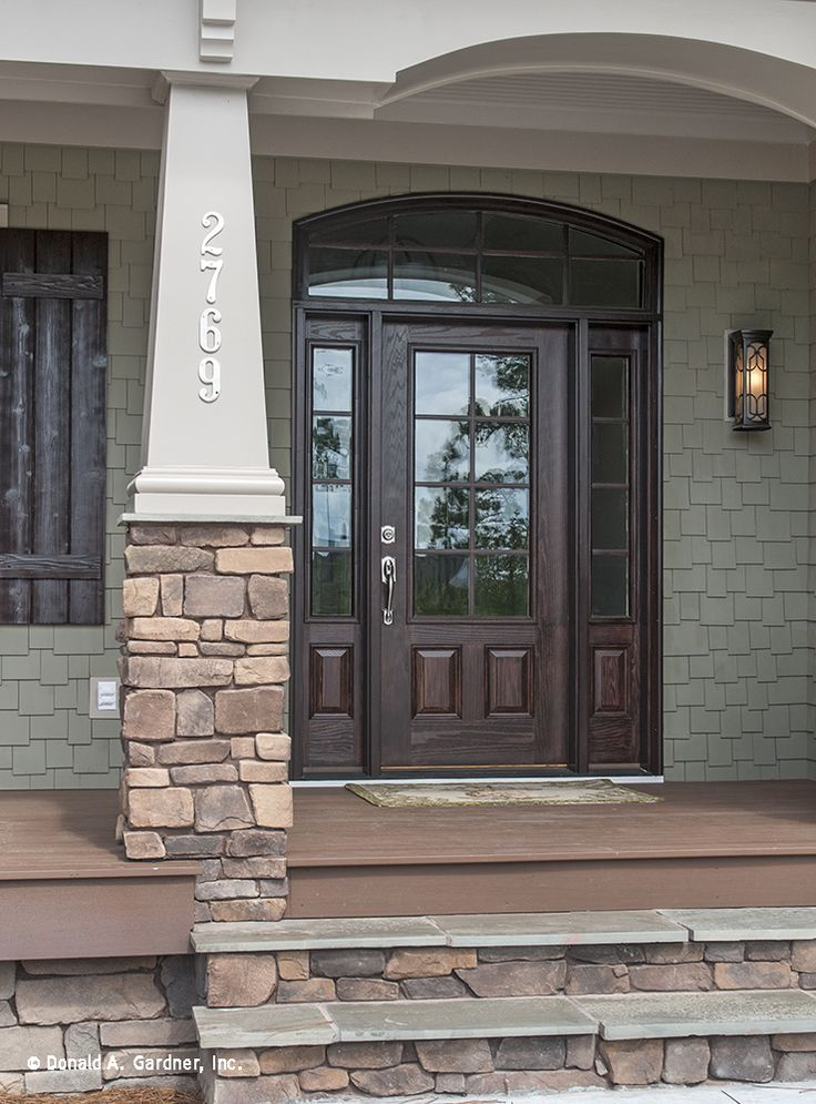 This front door has large windows that flood the foyer for House plans with columns and porches