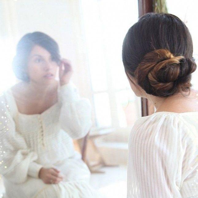 Wedding Chignon: Bridal hair DIY? We love that it's a thing. And the beauty of this basic pull back is that it can be easily amped up for the special celebration: try adding a few wisps of Baby's Breath or an ornate hair clip that counts as either something old or something new. (via She Lets Her Hair Down)