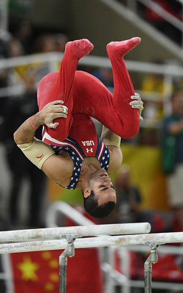 US gymnast Danell Leyva competes on parallel bars during the men's gymnastics team final Monday Aug 8 2016 at the Rio Olympic Games…