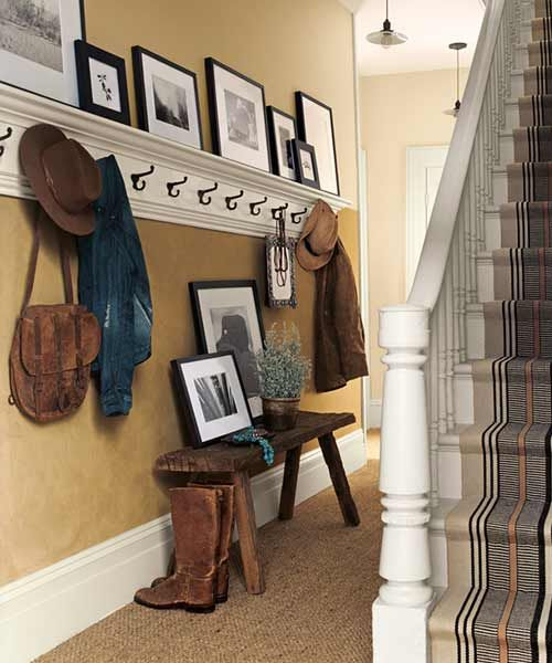 Traditional trim plays off the rough, suede-like texture and color of the walls in this gear drop-off spot.  Camino SU105 (wall), Raised Panel RL1235 (trim), @ralphlauren
